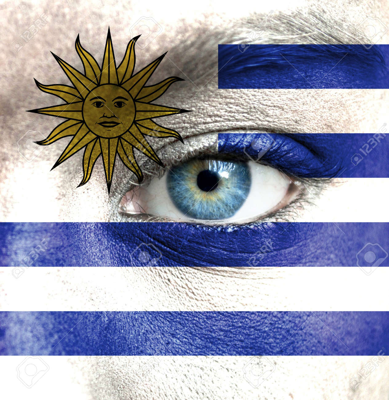 Human face painted with flag of Uruguay Stock Photo - 16523560