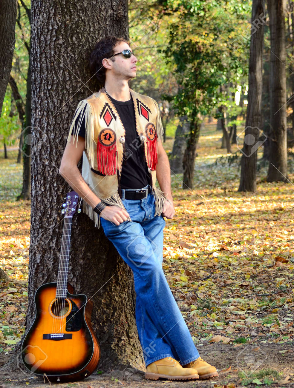 Man With Guitar Posing Stock Photo Picture And Royalty Free Image