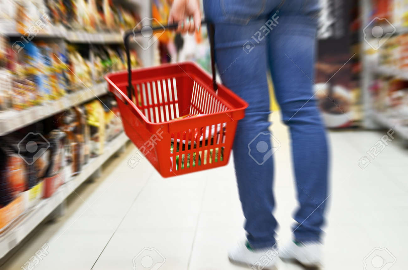 Hand holding empty shopping basket - Shopping concept - 22281549