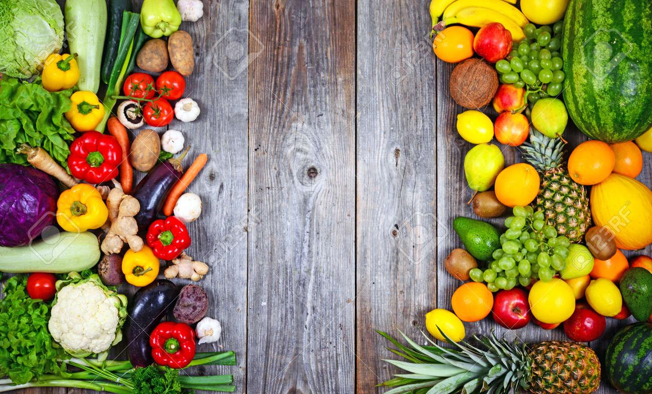 Huge group of fresh vegetables and fruit on wooden background - Vegetables VS Fruit - High quality studio shot - 31500480