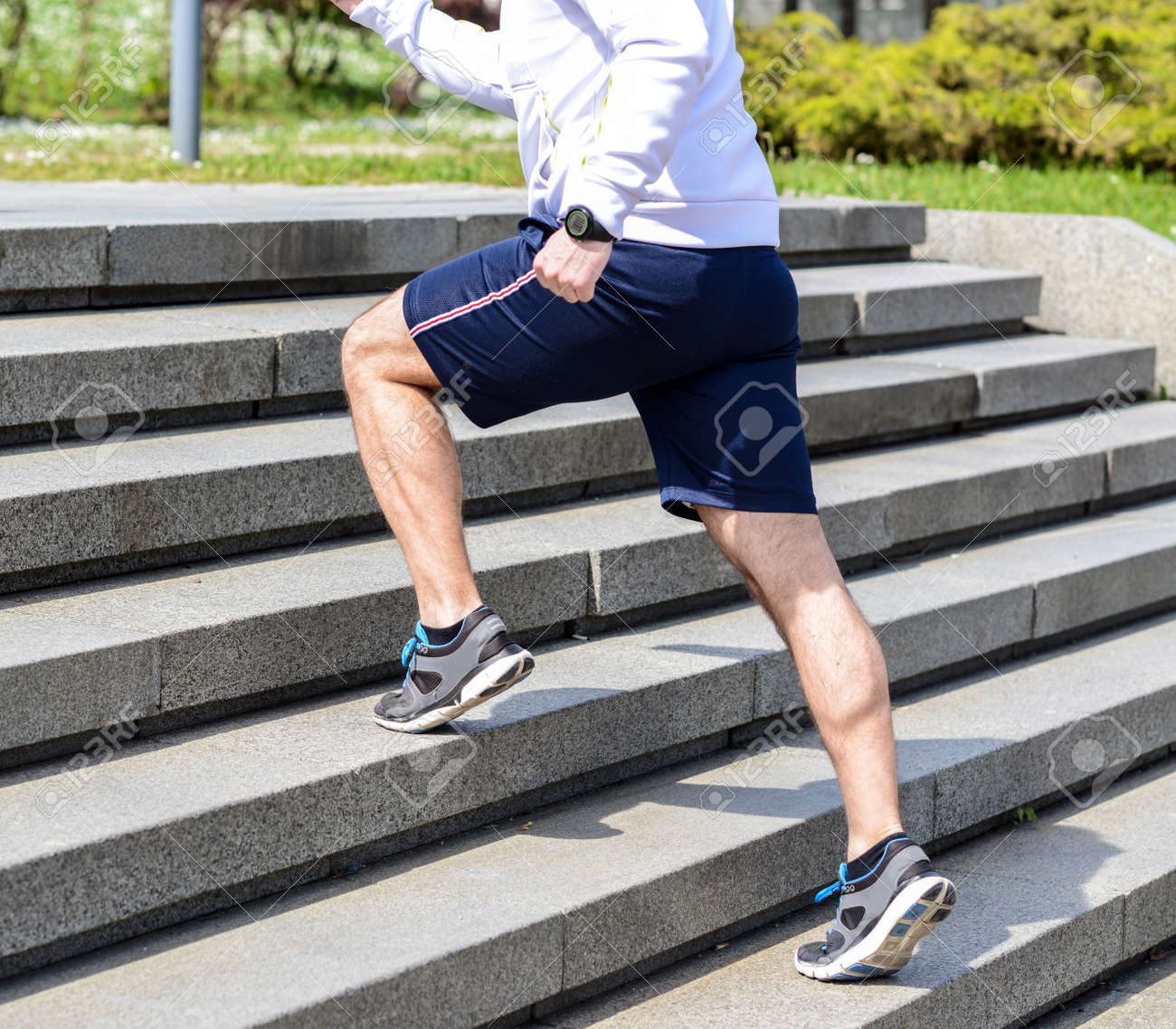 Practice - Close up of young man running up the stairs - 40252029