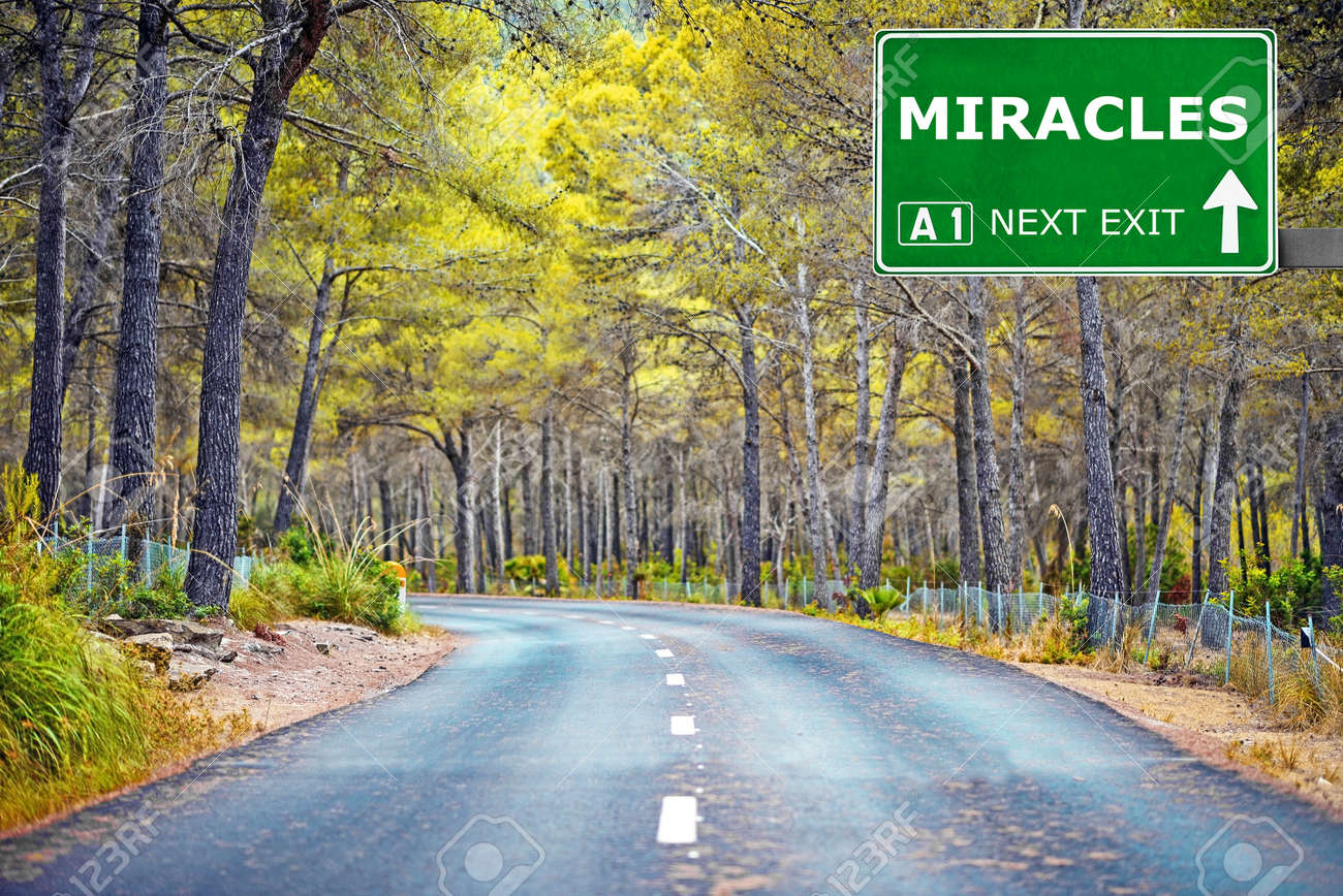 MIRACLES road sign against clear blue sky - 53696220