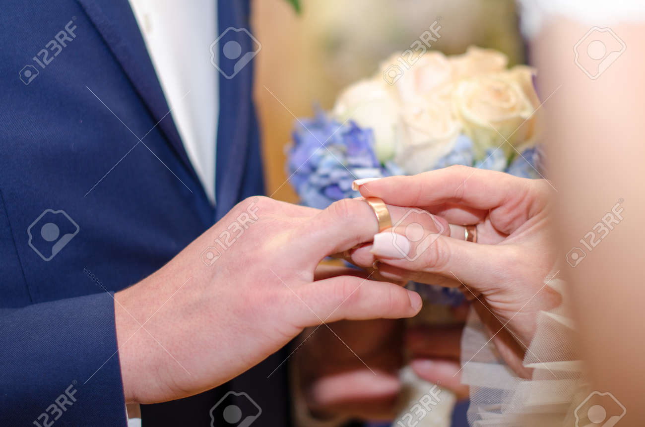 Love And Marriage. Wedding Ceremony. Bride Dresses Gold Ring.. Stock ...