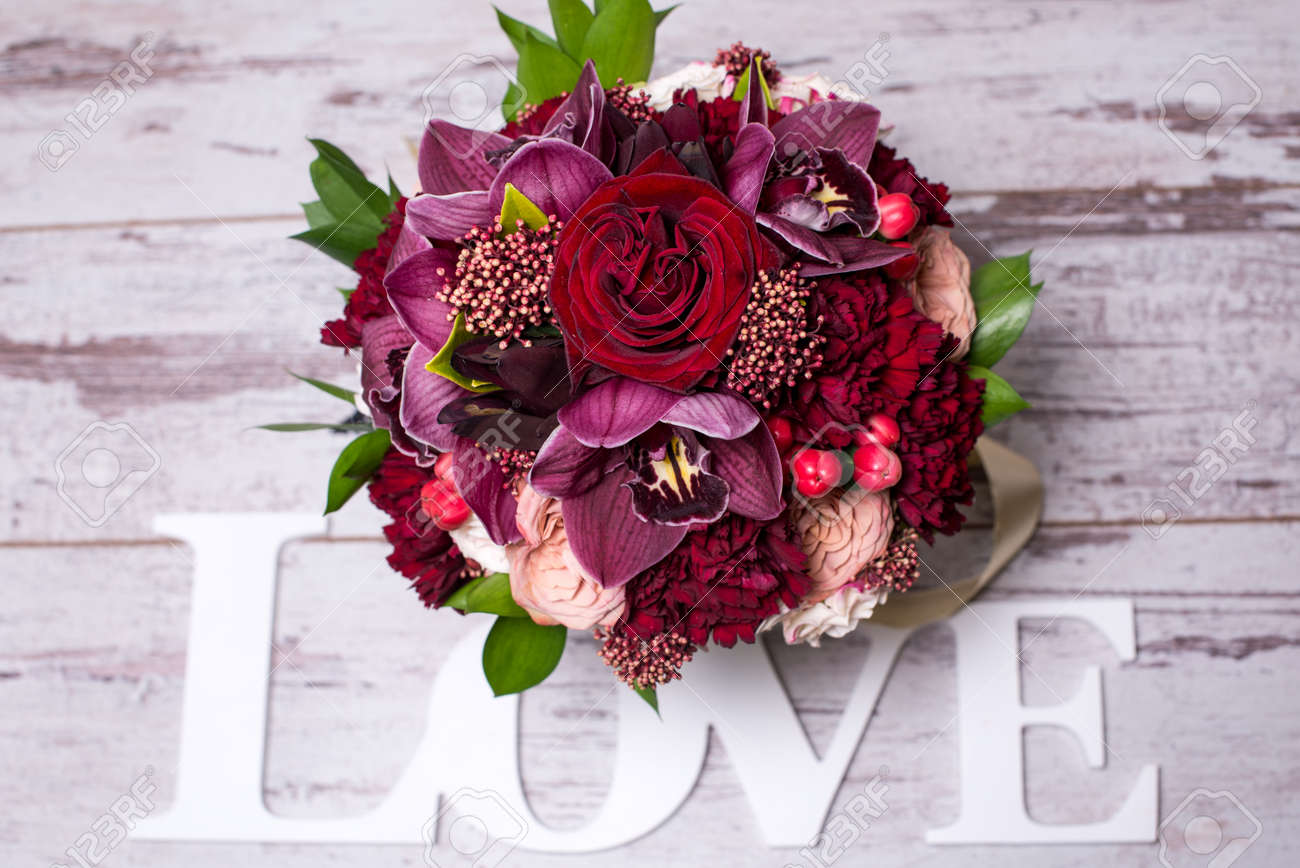 Beautiful flower arrangement with the inscription love on the beautiful flower arrangement with the inscription love on the shabby wooden table with space for text izmirmasajfo