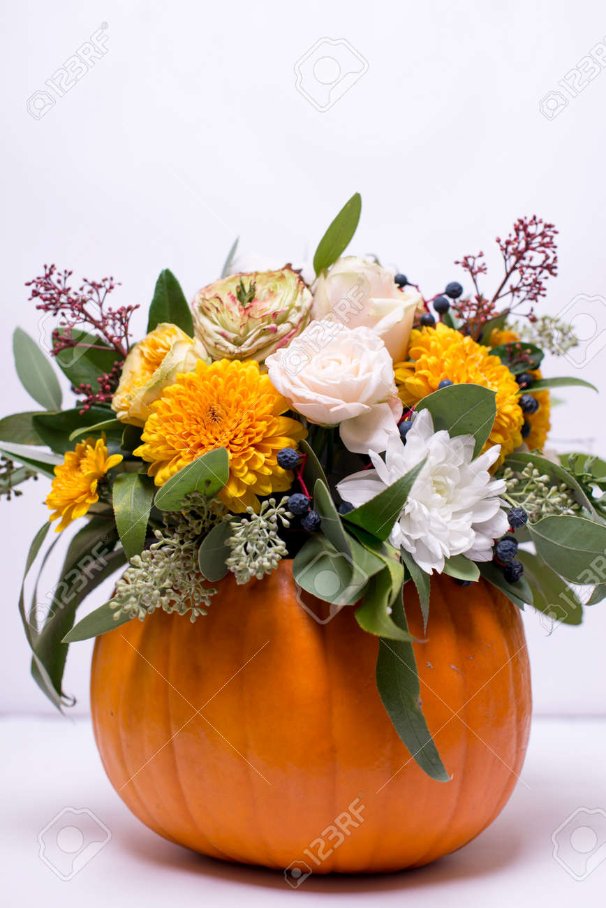 Autumn Floral Bouquet In A Pumpkin Vase On A Light Background Stock Photo Picture And Royalty Free Image Image 110739541