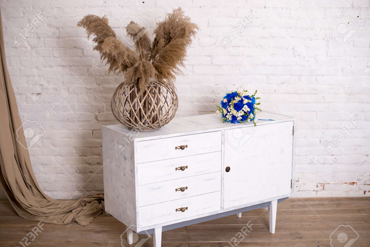 Picture of: White Wood Bedside Table Dresser In Bedroom Bridal Bouquet Stock Photo Picture And Royalty Free Image Image 111181245