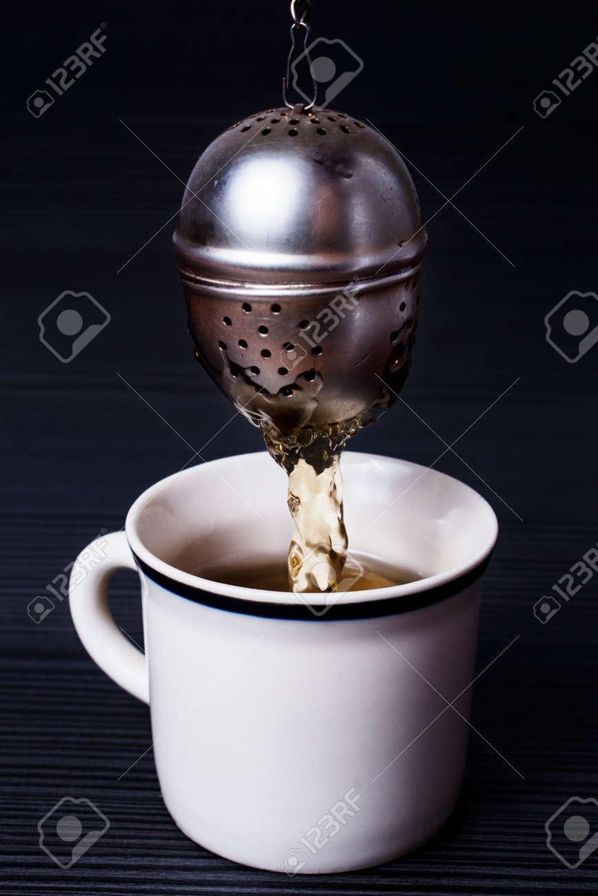 Infuser making tea Stock Photo - 52482066