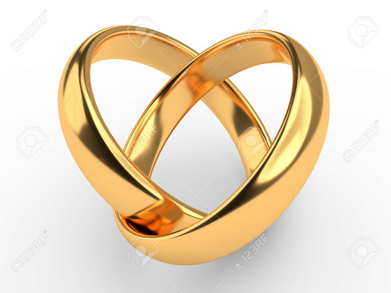Heart With Two Connected Gold Wedding Rings Stock Photo Picture And