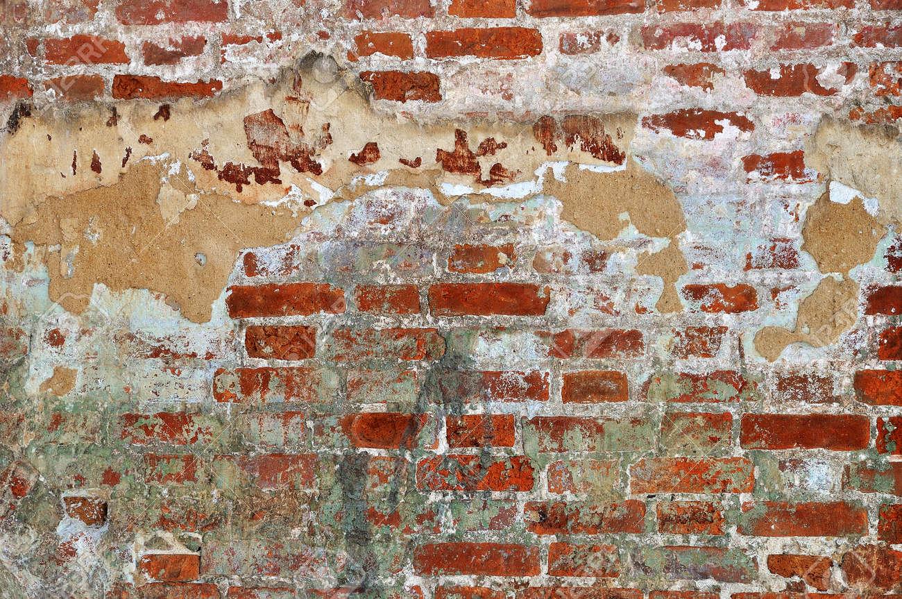 Old red bricks weathered damaged wall background Stock Photo - 13604897