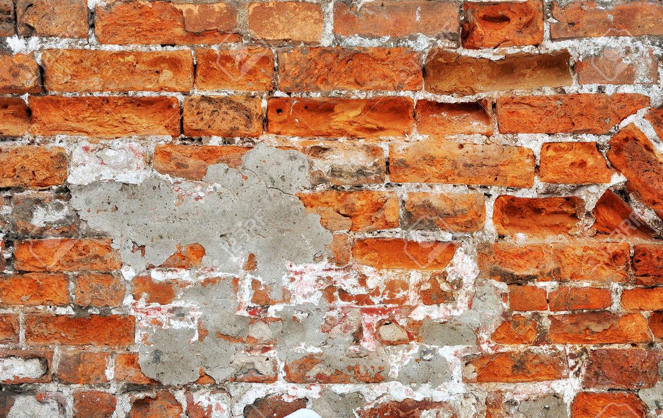 Old red bricks weathered damaged wall background Stock Photo - 13704036