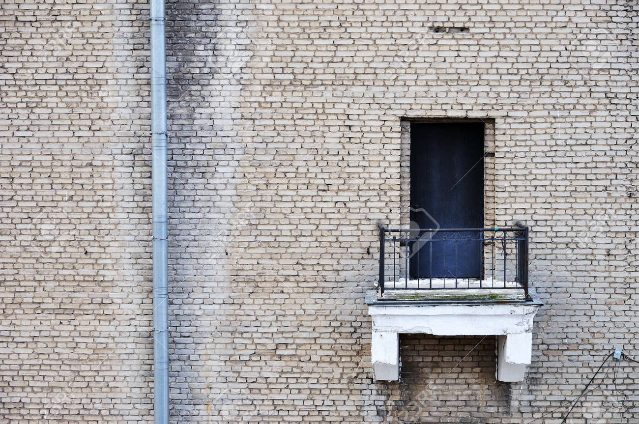 Old gray bricks weathered wall with balcony vintage background Stock Photo - 13704021