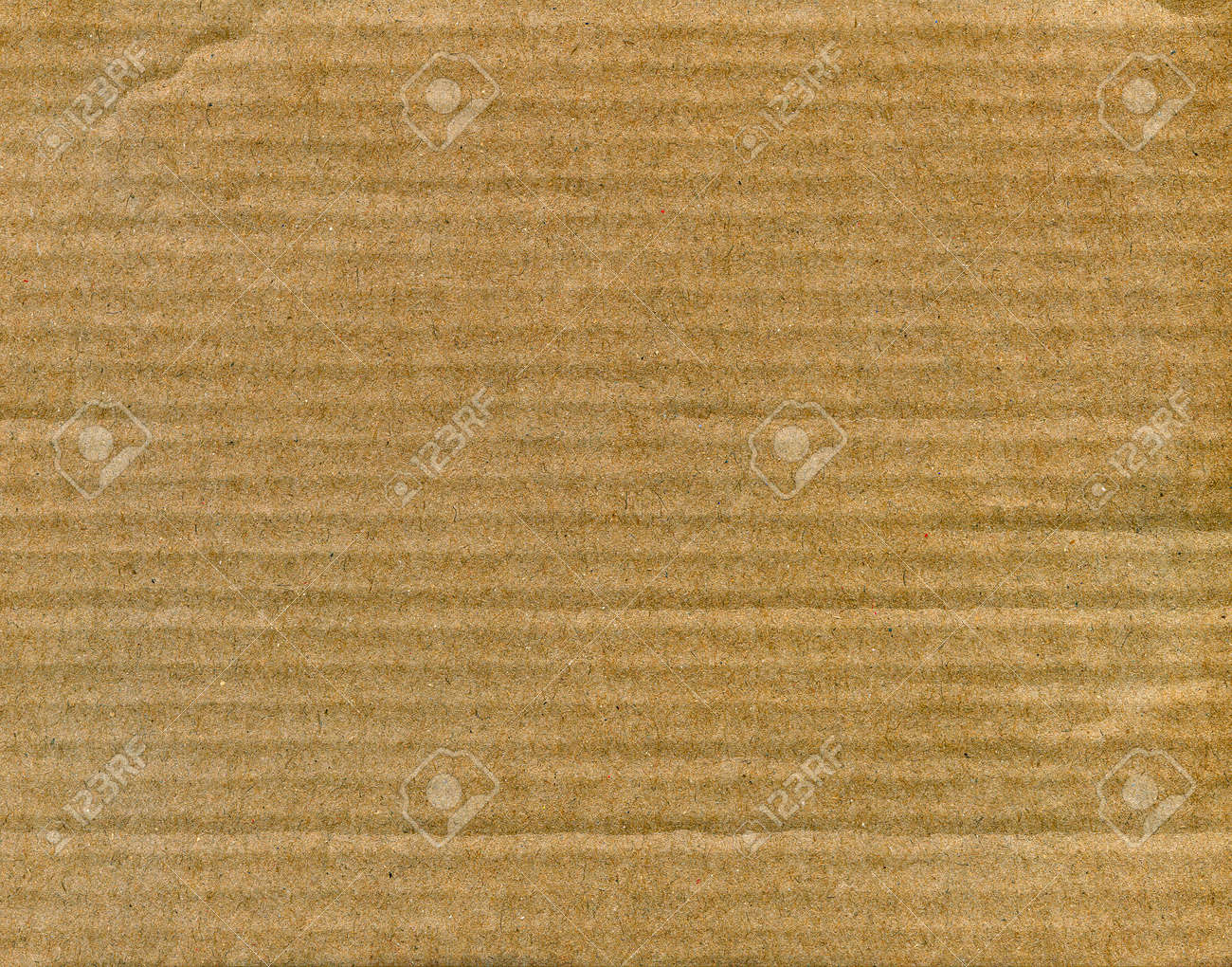 Textured striped recycled cardboard with natural fiber parts Stock Photo - 15752070