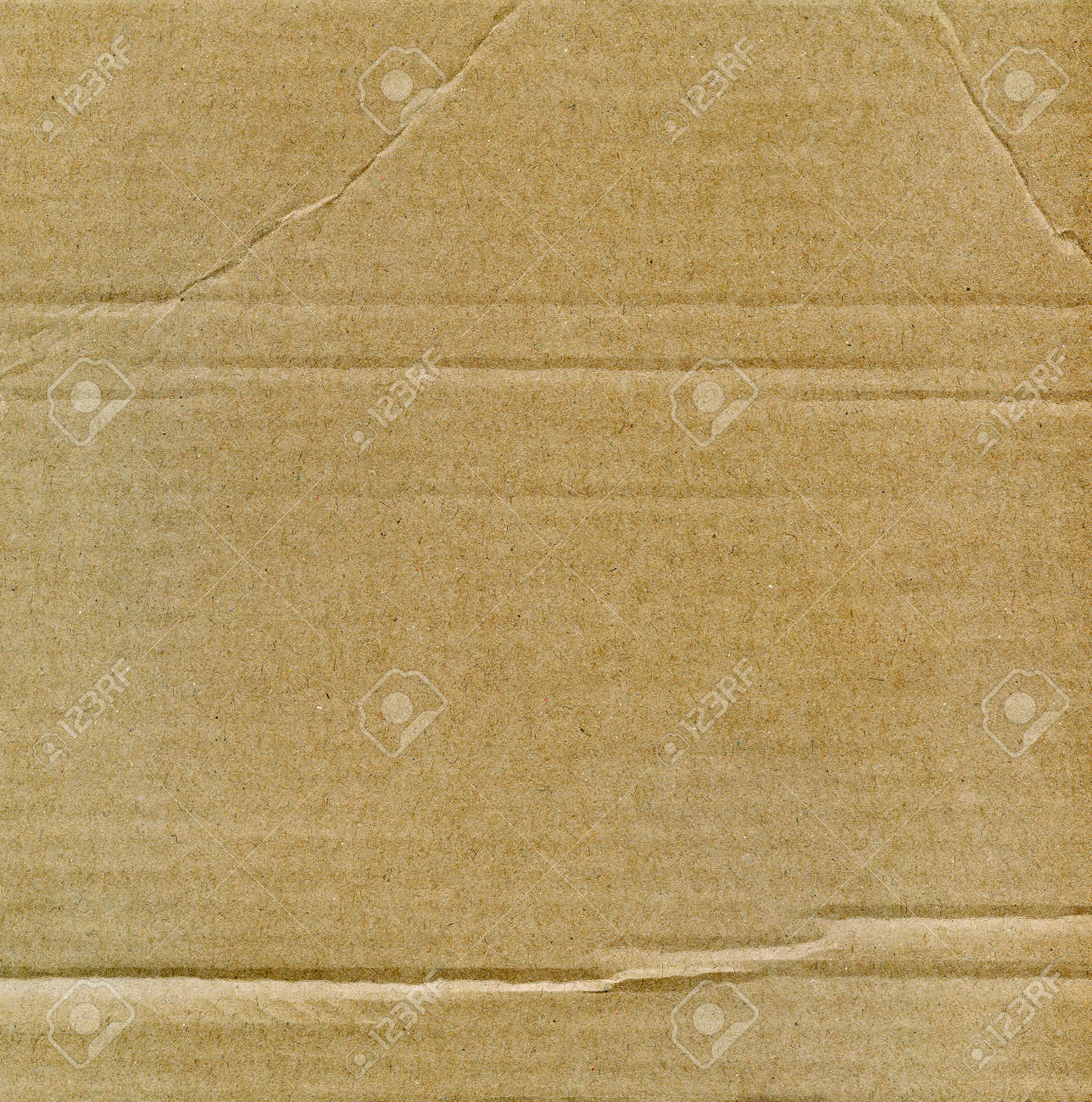 Textured recycled cardboard with natural fiber parts Stock Photo - 15840279