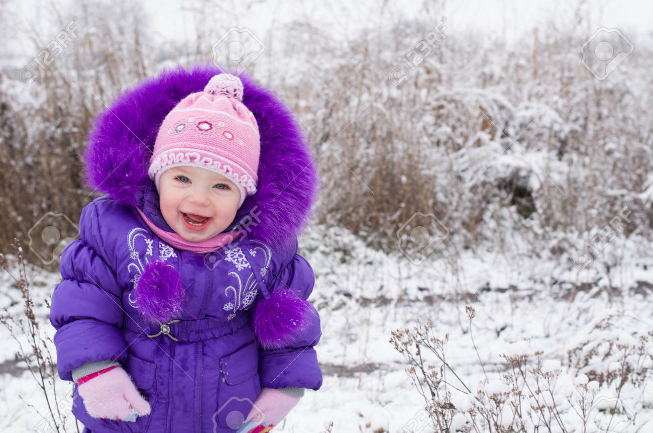 Portrait of happy little girl in snowy landscape Stock Photo - 16800540