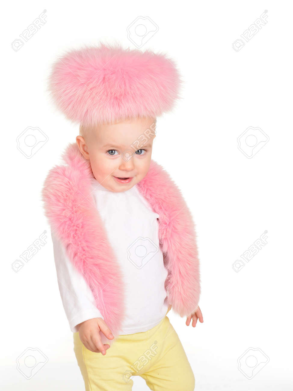 cc6a3d1e6 Cute Baby Girl Dressed In Pink Fur Play On White Background Stock ...