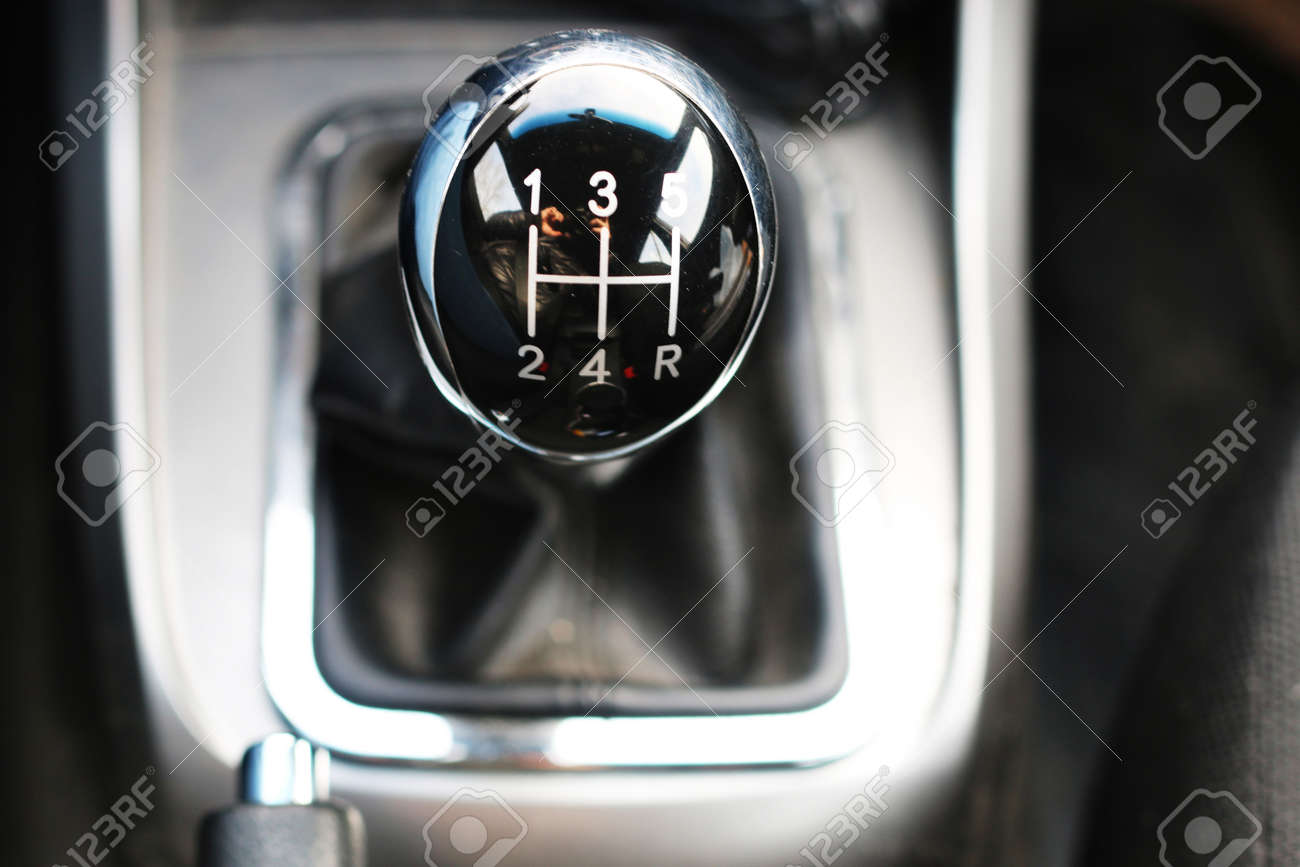 black shiny handle manual gearbox five-speed on the center of the frame  Stock Photo