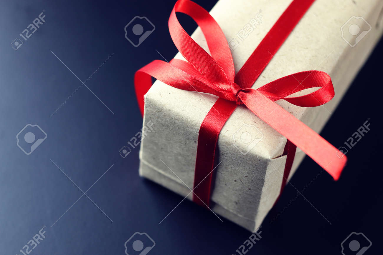 Christmas Greetings And Gifts On A Black Matte Background Wallpaper