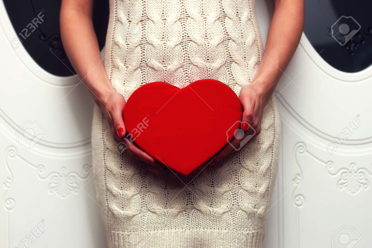 object red heart-shaped hands holding a young person - 65244808