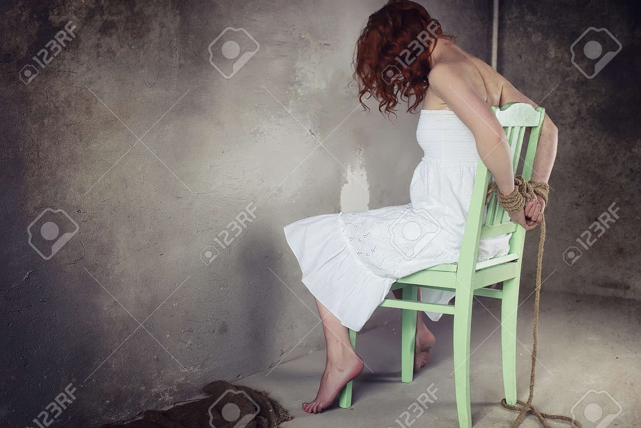 young girls tied up Stock Photo - Young girl tied up on the floor. The abducted girl. The  victim o