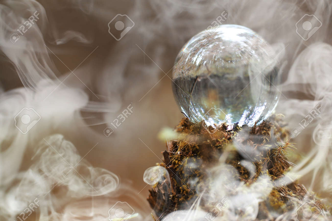 A crystal ball in the smoke. A magical accessory in the woods on - 96449791
