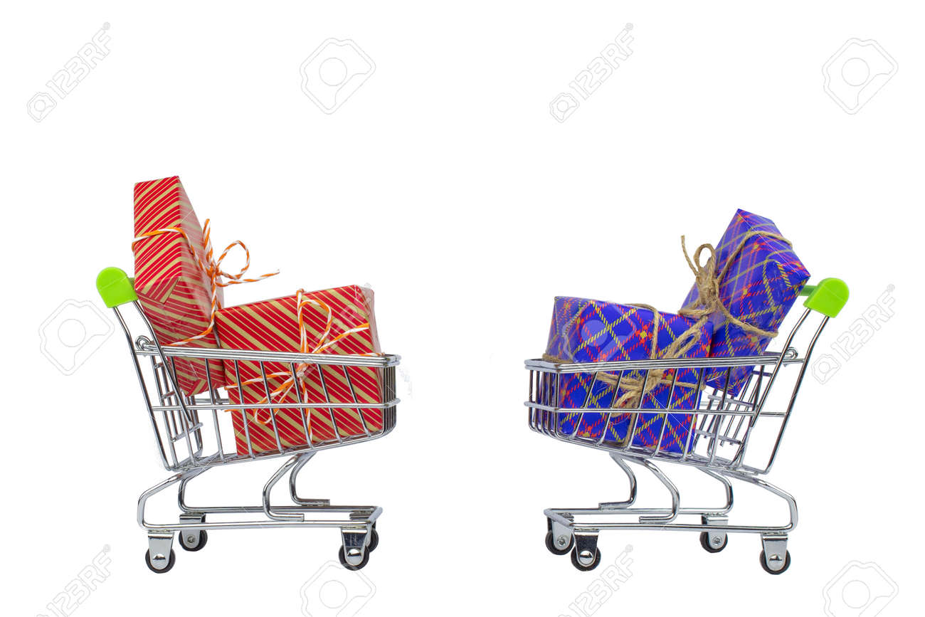 Two shopping carts with gift boxes on a white background. - 157257293