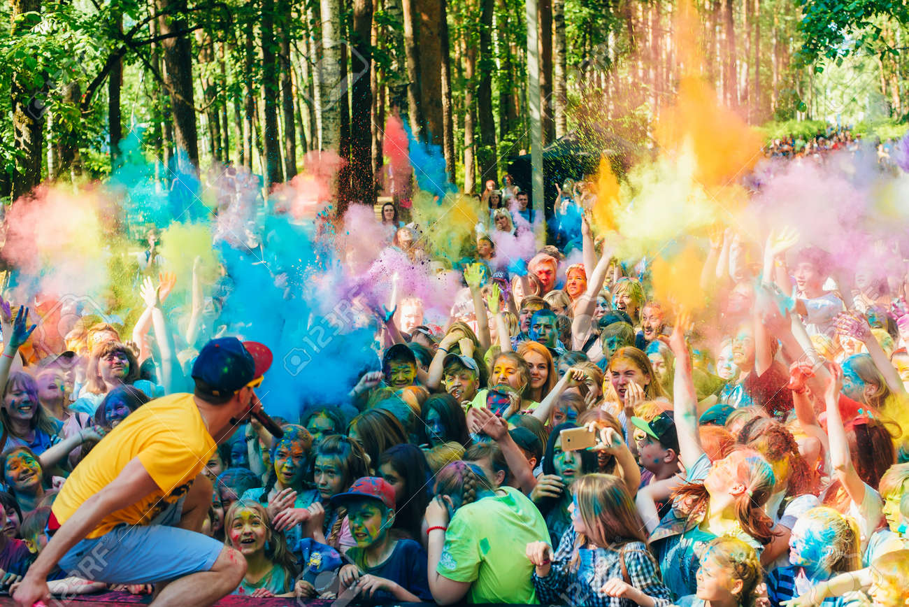 VICHUGA, RUSSIA - JUNE 17, 2018: Crowd of happy people at the celebration of the festival of colors Holi - 133573759