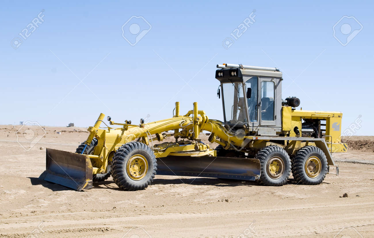 A construction vehicle flattening a field Stock Photo - 19736993