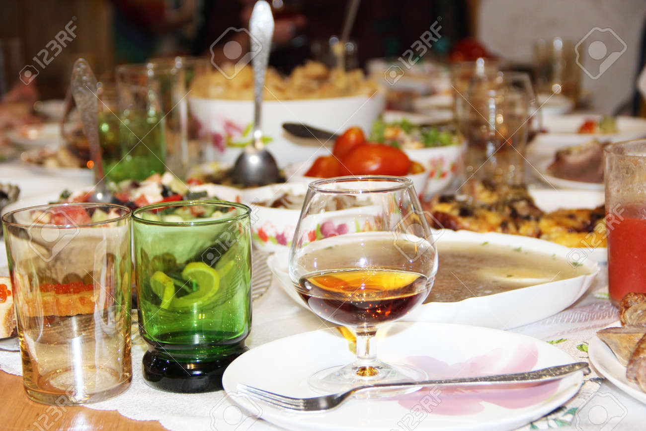 Holiday table setting. Festive table with delicious dishes. Many food on table for family holiday. Festive food served on table. Set of different meaty and vegetable dishes. Festive dinner at home - 167483100
