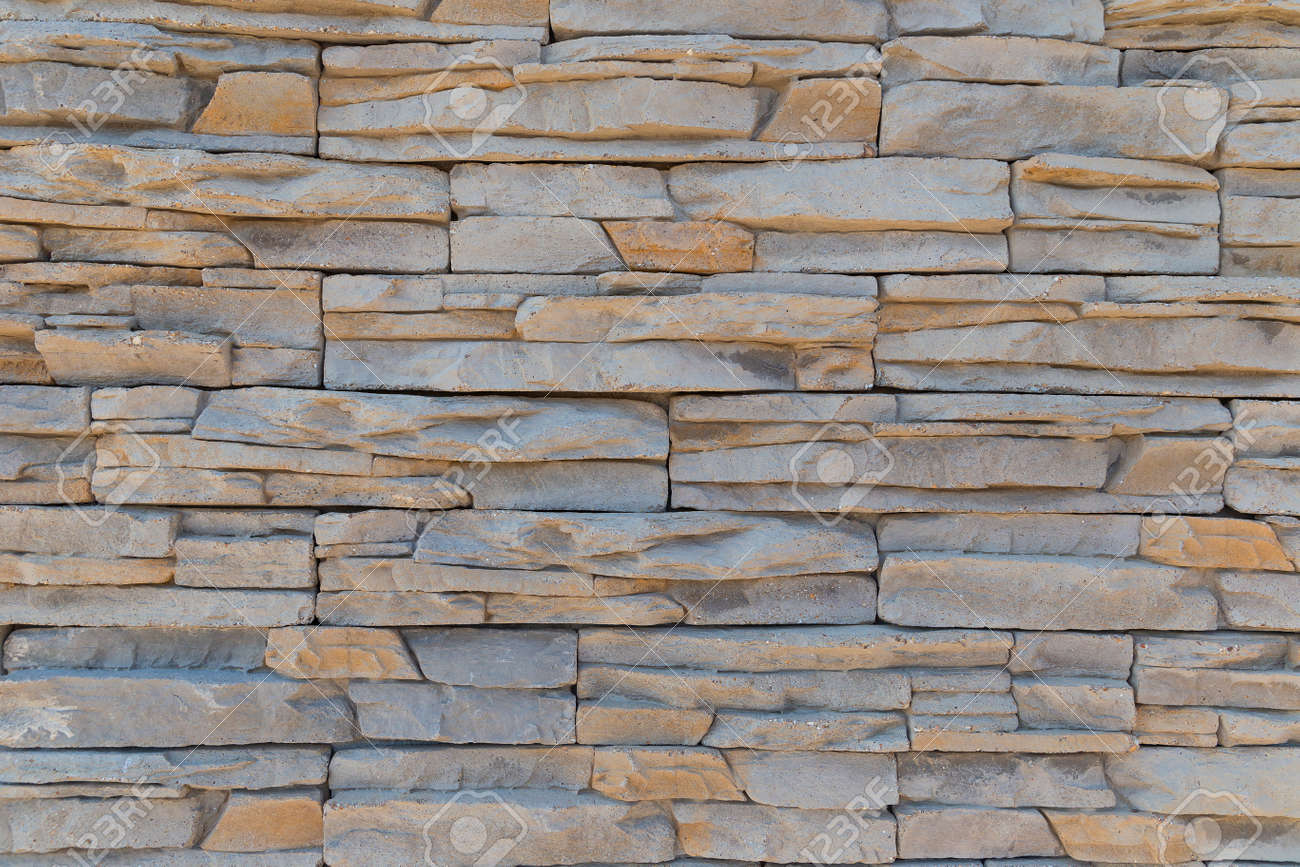 The texture of the wall of a variety of colored stones - 125392059