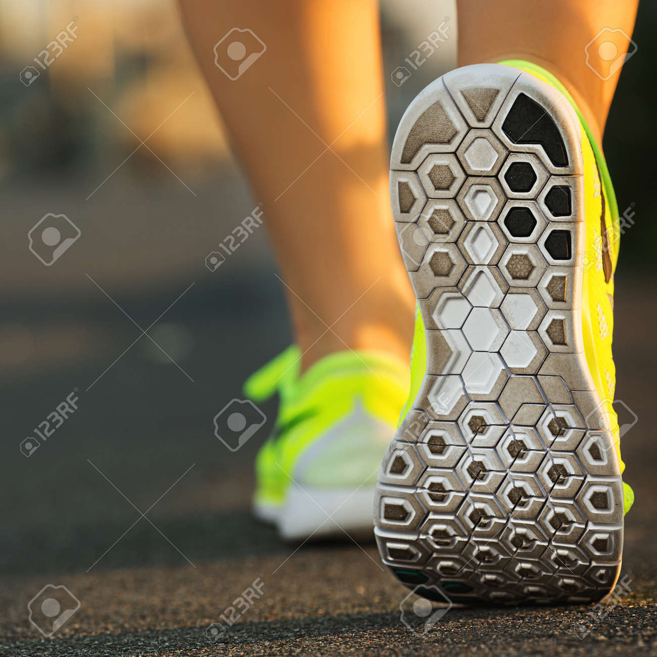 Runner woman feet running on road closeup on shoe. Female fitness model sunrise jog workout. Sports healthy lifestyle concept. - 31878070