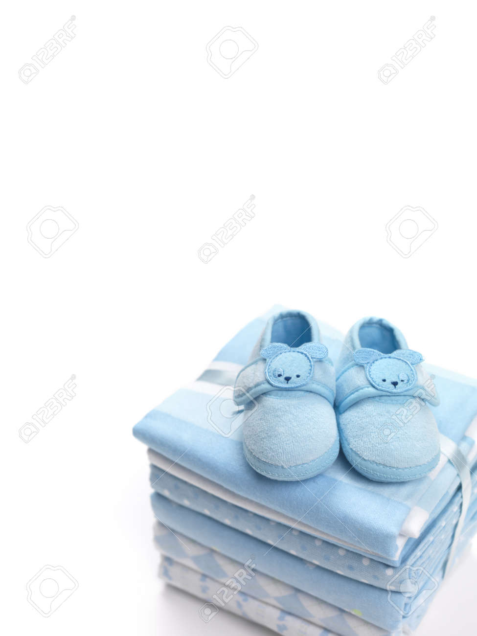 Cute Blue Baby Boy Shoes On A Pile Of
