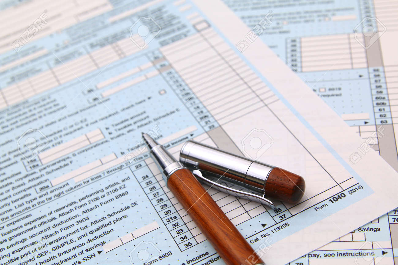 1040 Income Tax Form And Pen Finance Concept Over A White