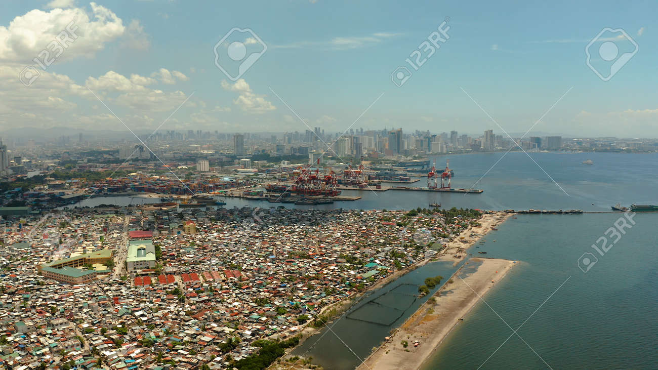 Manila city with port, skyscrapers, modern buildings and Makati business center at sunset, aerial drone. Travel vacation concept - 168138050