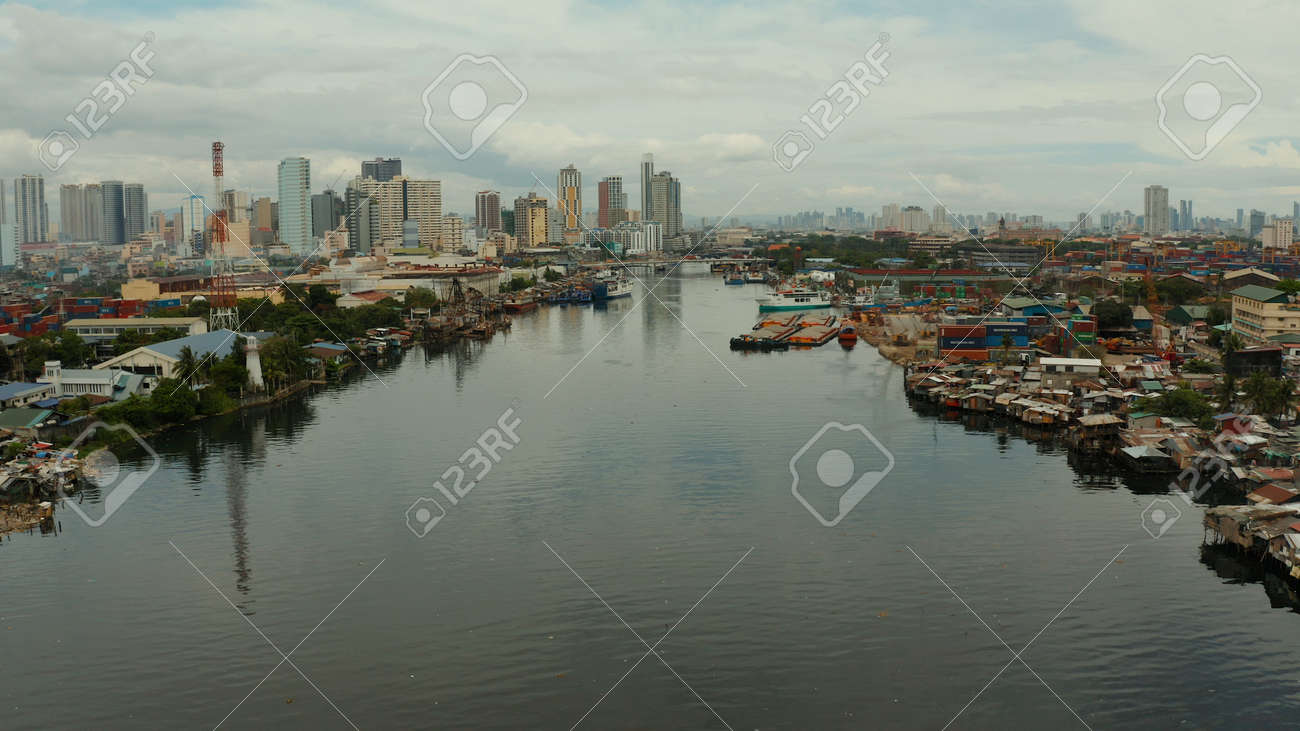 Populous city of Manila, the capital of the Philippines with skyscrapers, streets and buildings. Travel vacation concept. - 168138052