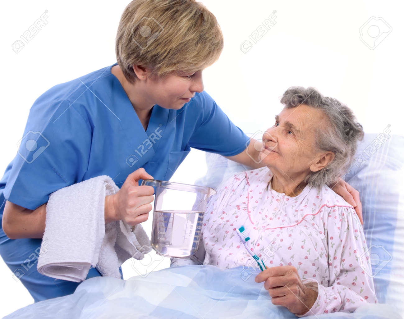 Nurse helps the senior woman in washing Stock Photo - 4172811