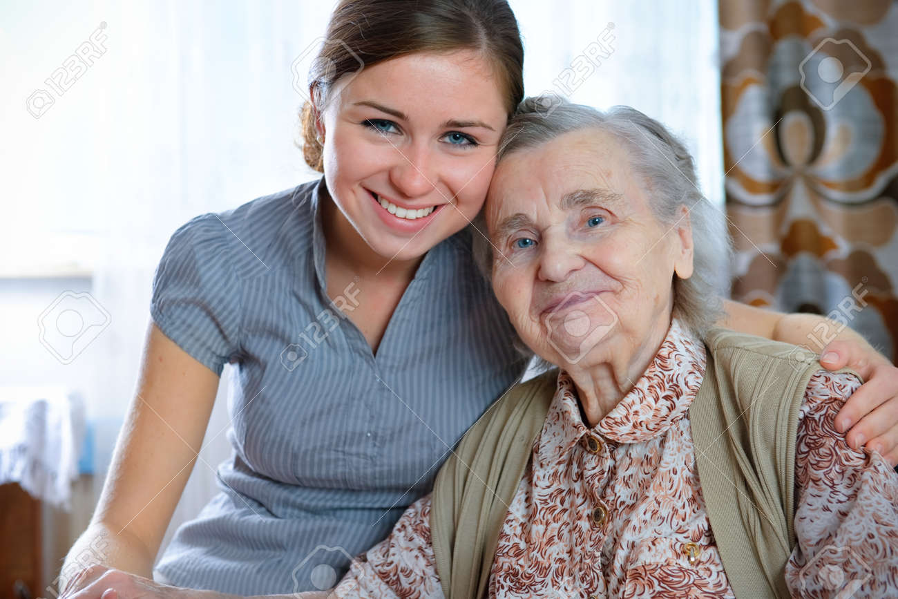 Senior woman with her home caregiver Stock Photo - 7908034