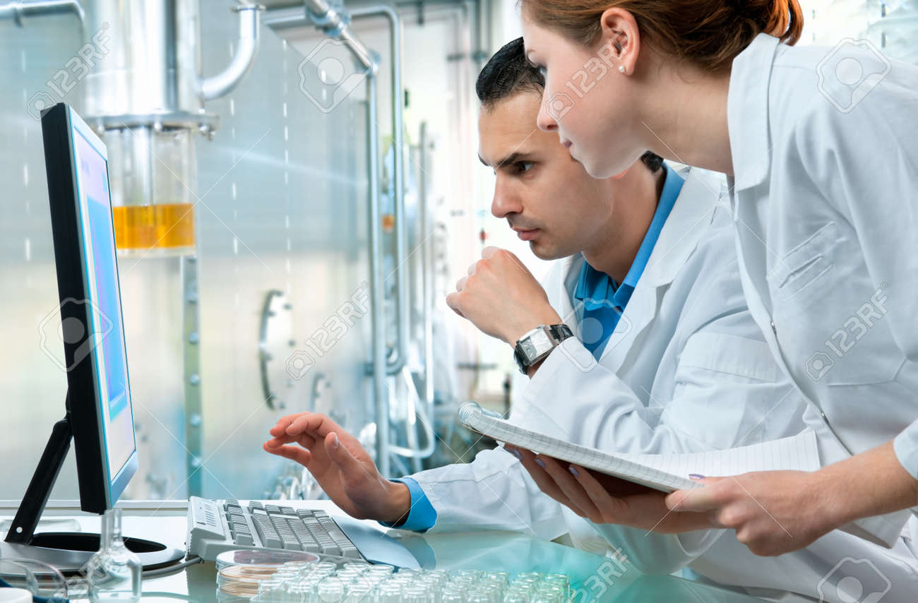 group of scientists working at the laboratory Stock Photo - 8987270