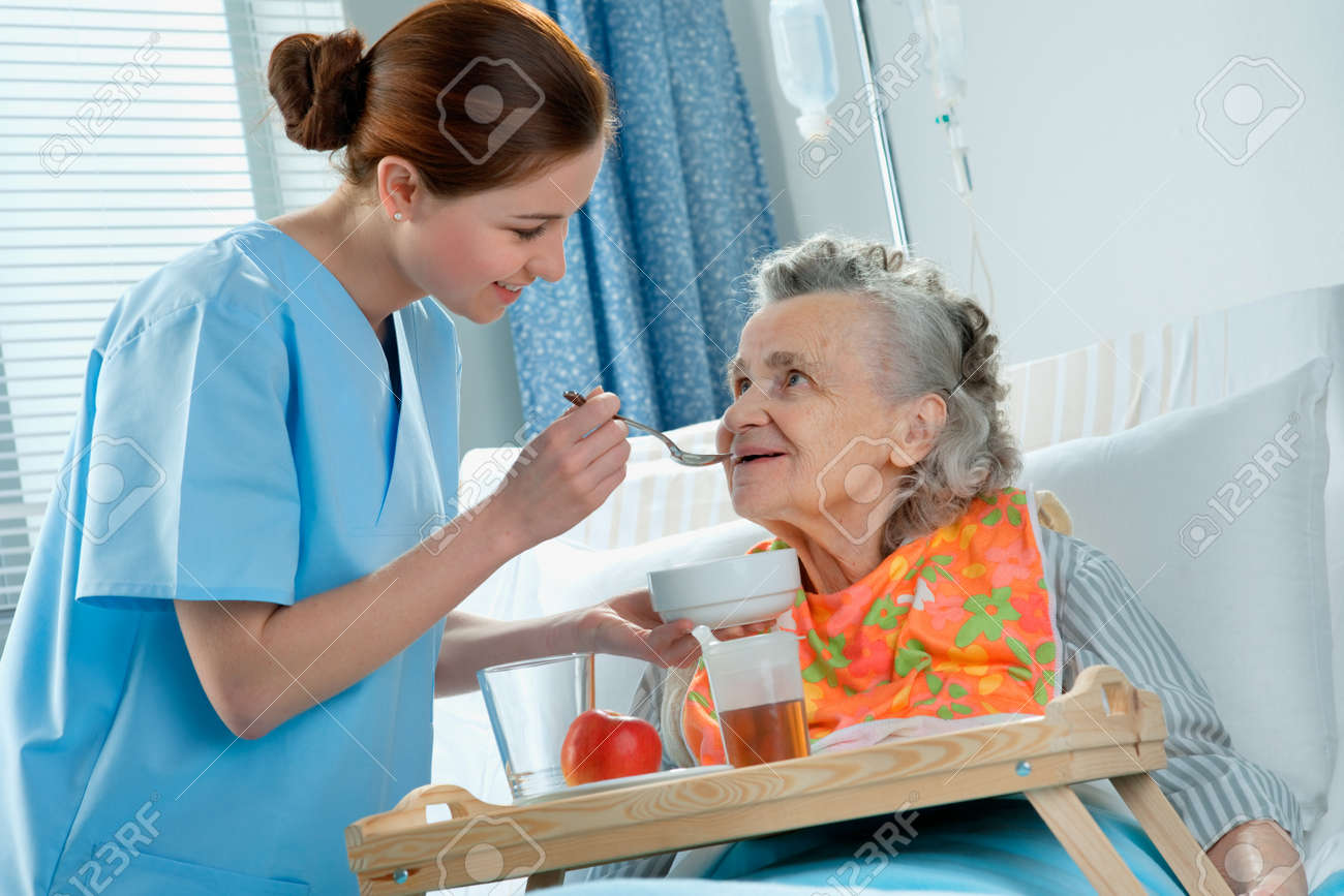 senior woman 90 years old being fed by a nurse Stock Photo - 9166196