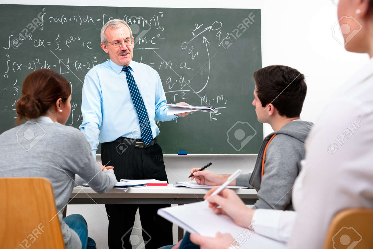 teacher with a group of high school students  in classroom Stock Photo - 12616138