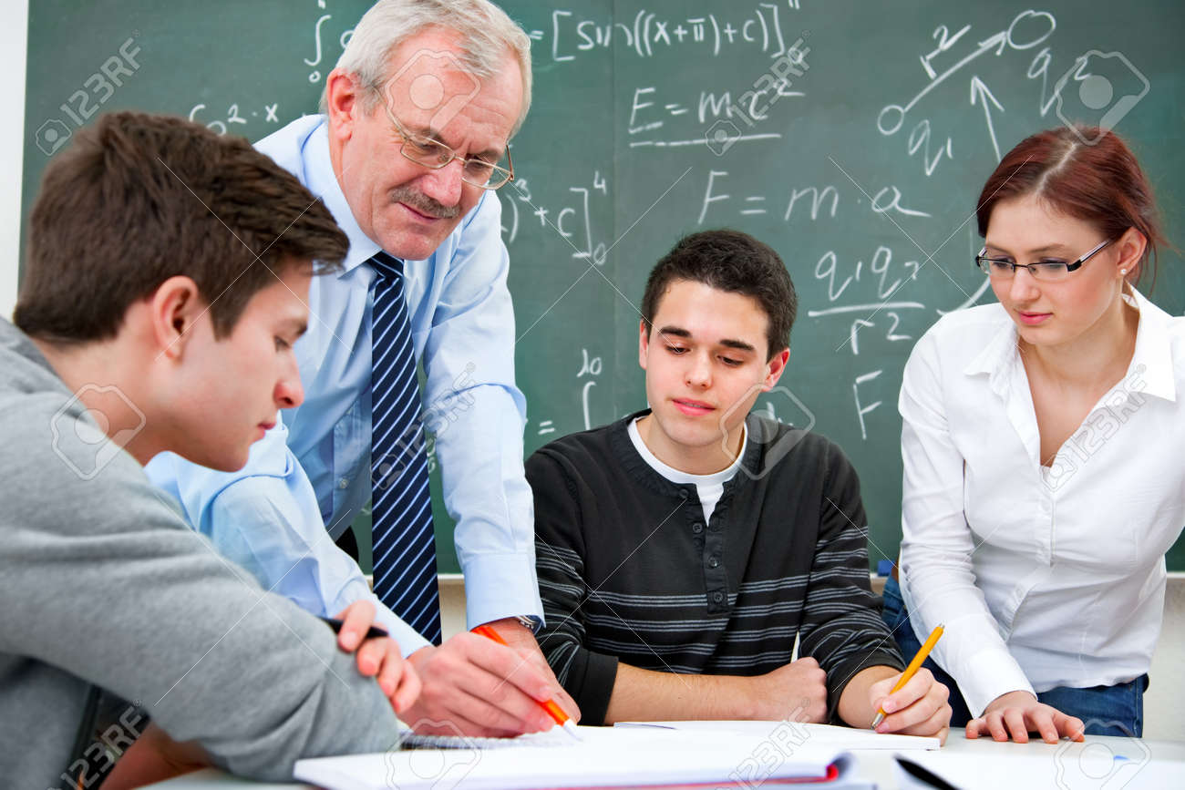 teacher with a group of high school students  in classroom Stock Photo - 12616161