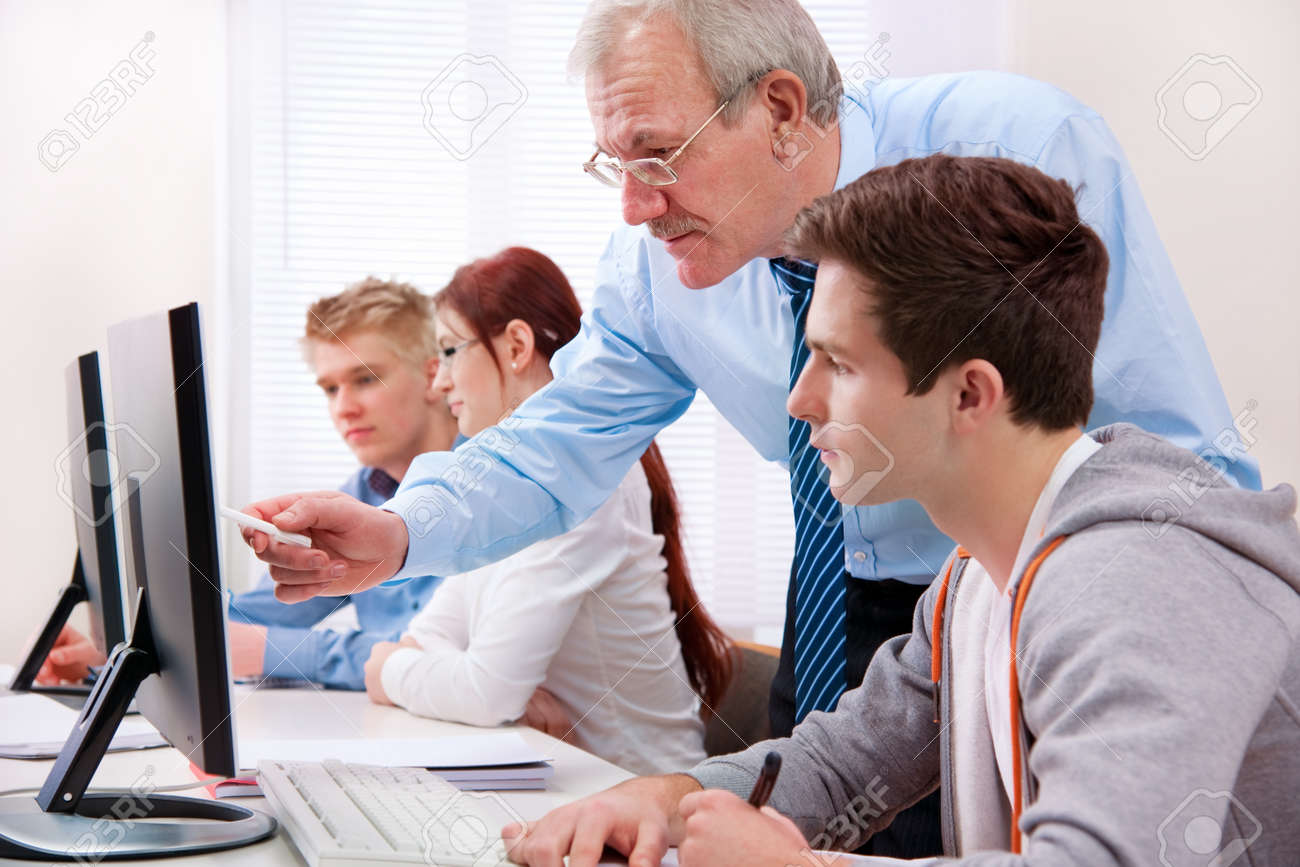 Students with a teacher in computer classroom Stock Photo - 12616233