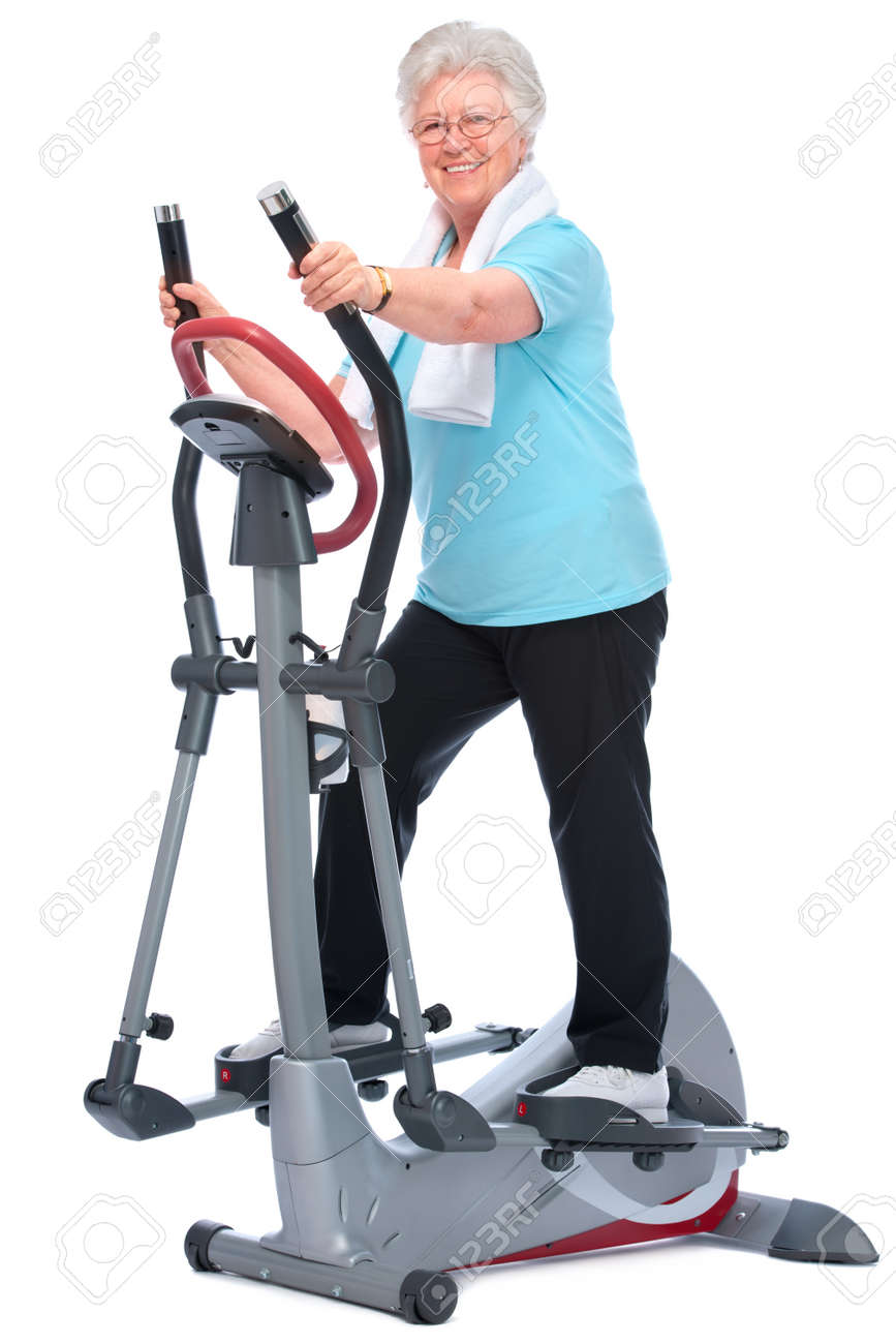Attractive senior woman at health club, exercising on stepper Stock Photo - 13203122