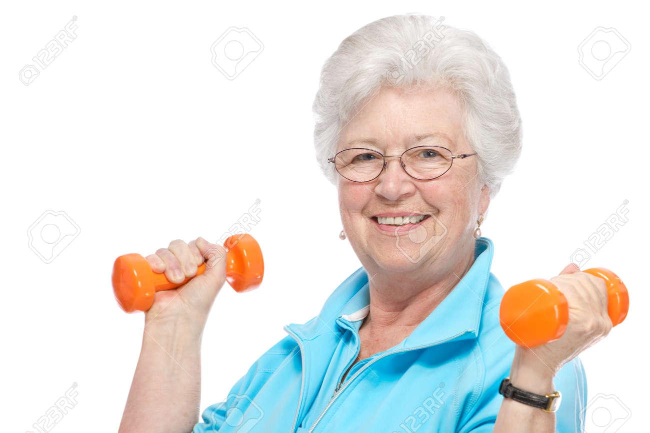 Happy senior woman making fitness training with dumbbells Stock Photo - 13336399