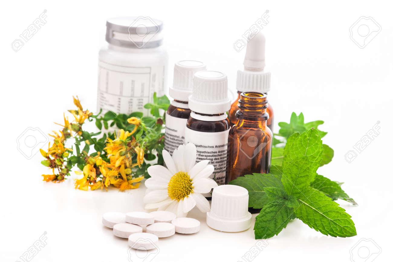 Healing herbs and medicinal bottles. Alternative medicine concept - 14304960