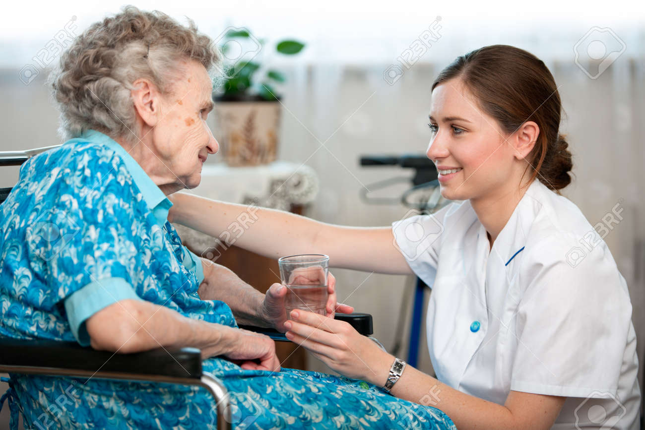 Senior woman with her caregiver at home Stock Photo - 14298404