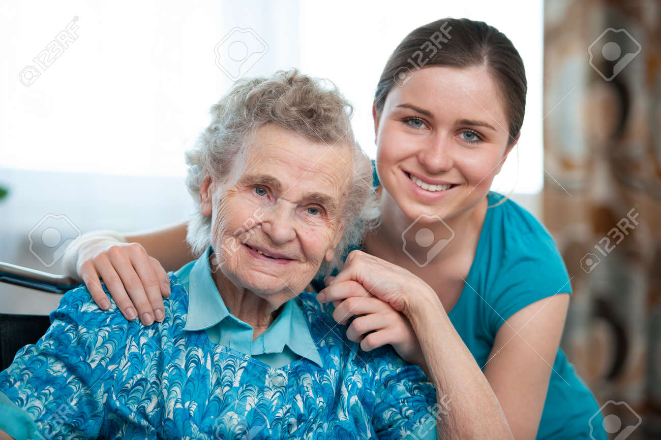Senior woman with her caregiver at home Stock Photo - 14456388