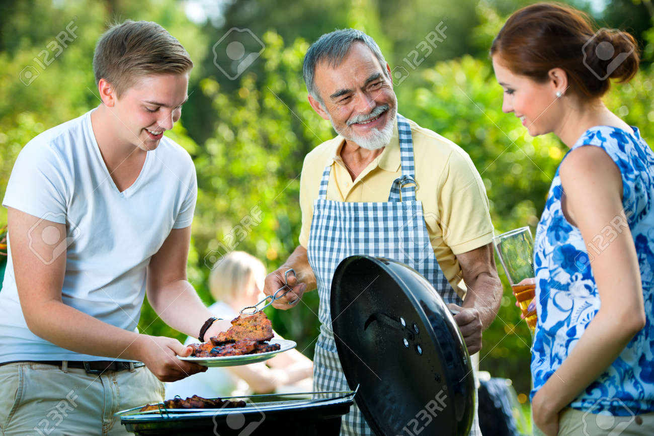 Family Garden Party Family Having a Barbecue Party