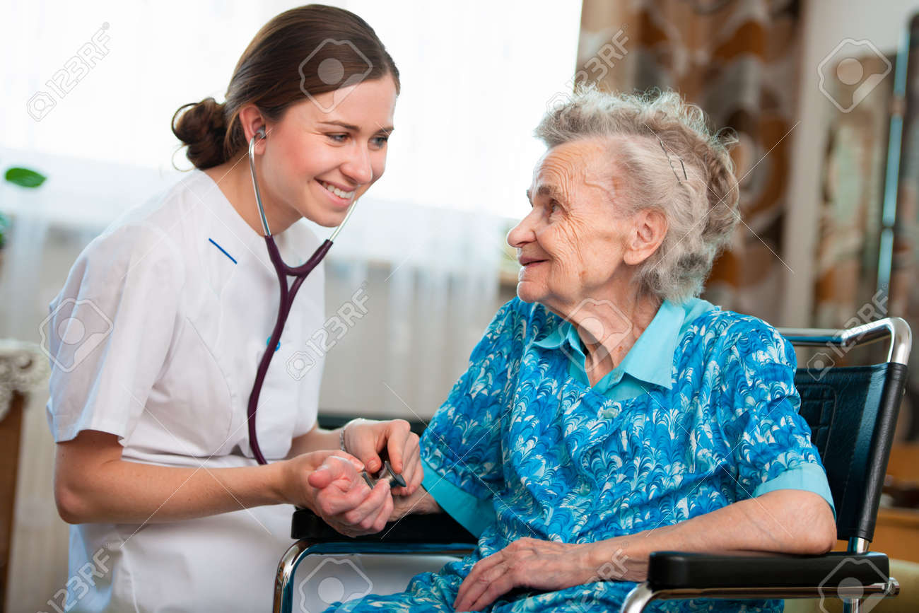 Senior woman with her caregiver at home Stock Photo - 14995020
