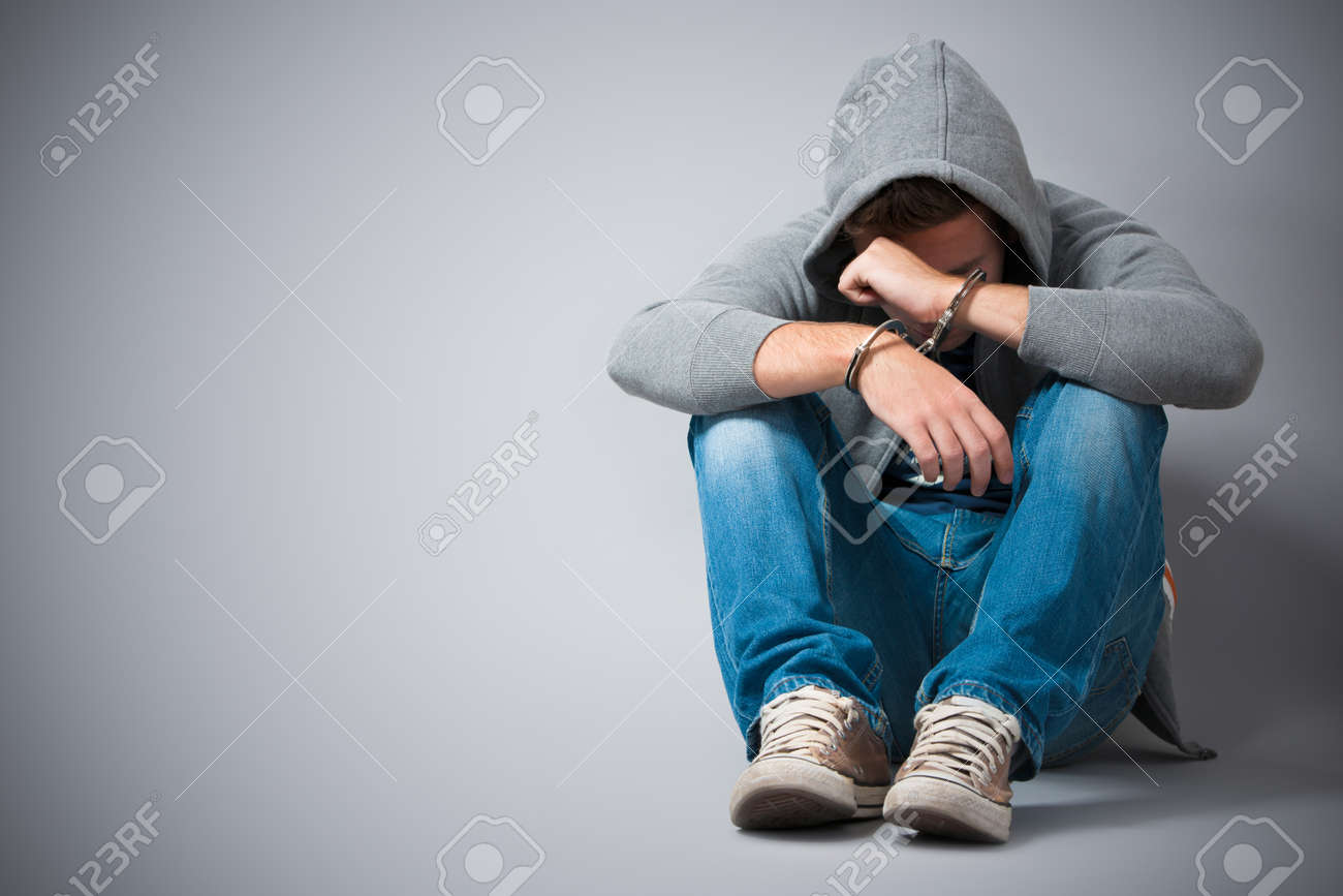 Arrested teenager with handcuffs on his hands Stock Photo - 14995026