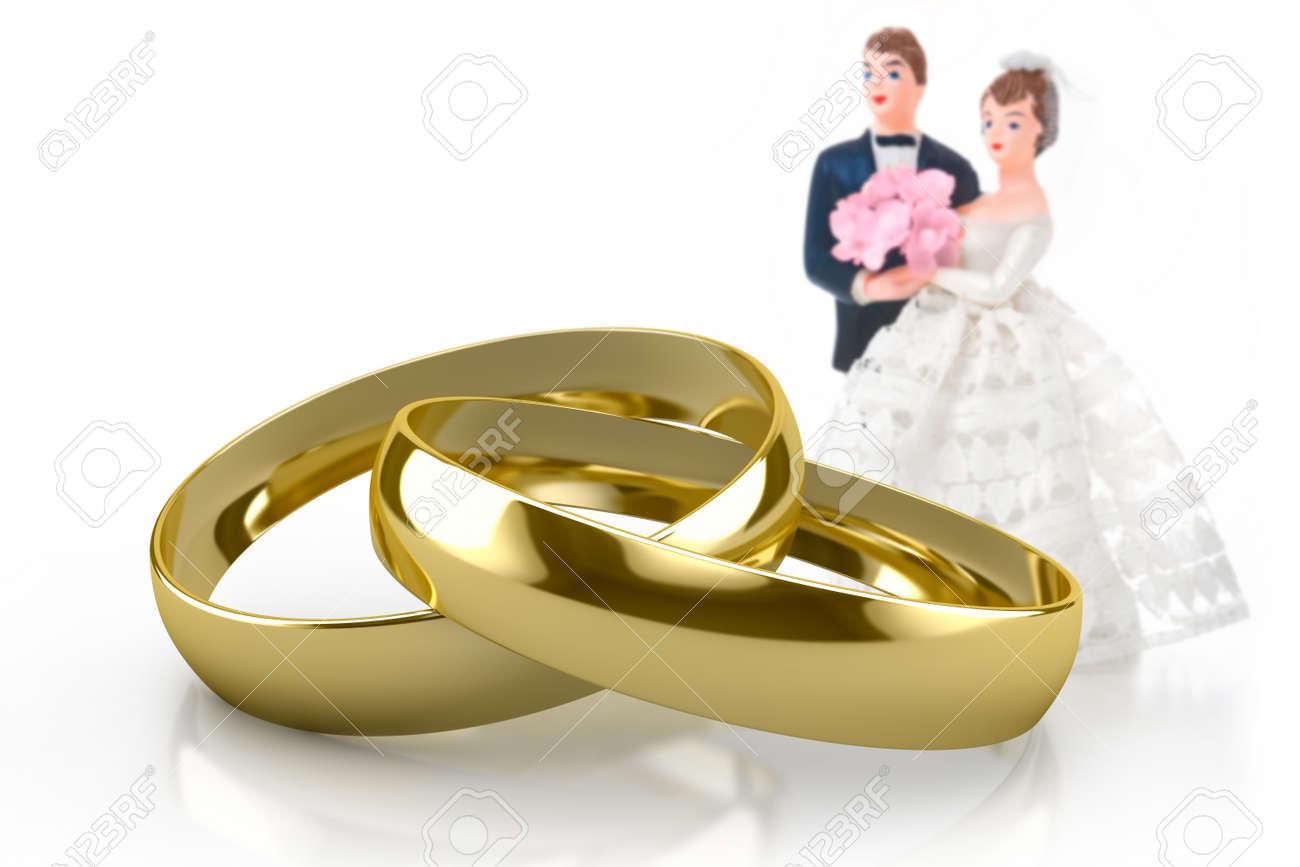 Couple Of Gold Wedding Rings On White Background Stock Photo